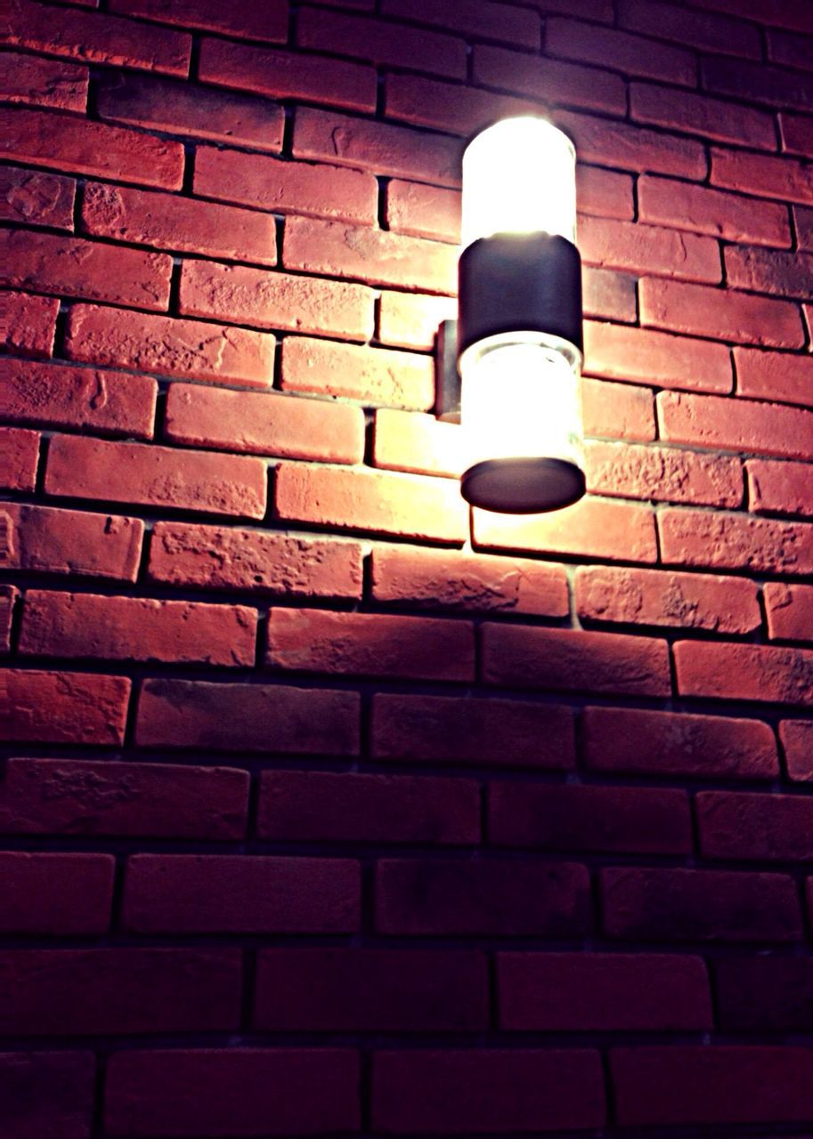 brick wall, electricity, lighting equipment, illuminated, wall - building feature, light bulb, electric light, no people, glowing, red, low angle view, close-up, night, indoors, architecture, technology