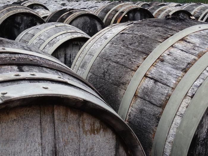 Close-up of barrels in factory