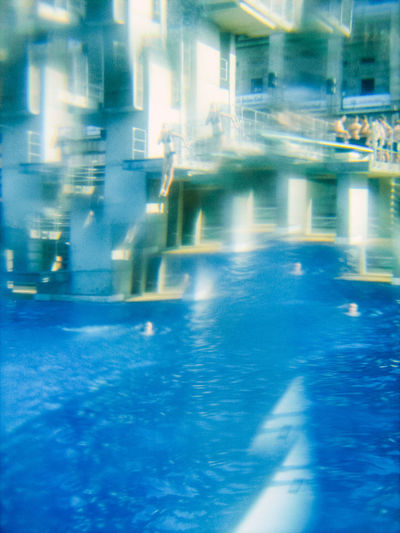 Reflection of people in swimming pool
