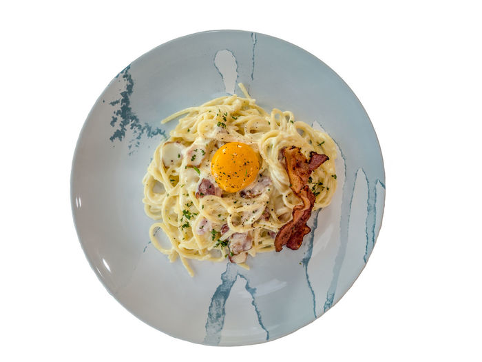 Spaghetti carbonara with crispy bacon and egg. A special meal in Italian style, always temptation to everyone. One of favorite Italian traditional dish. Spaghetti Bacon Breakfast Cheese Directly Above Egg Egg Yolk Food Food And Drink Freshness Fried Fried Egg Gourmet Healthy Eating Italian Food Meal Pasta Plate Ready-to-eat Serving Size Still Life Studio Shot Temptation Wellbeing White Background