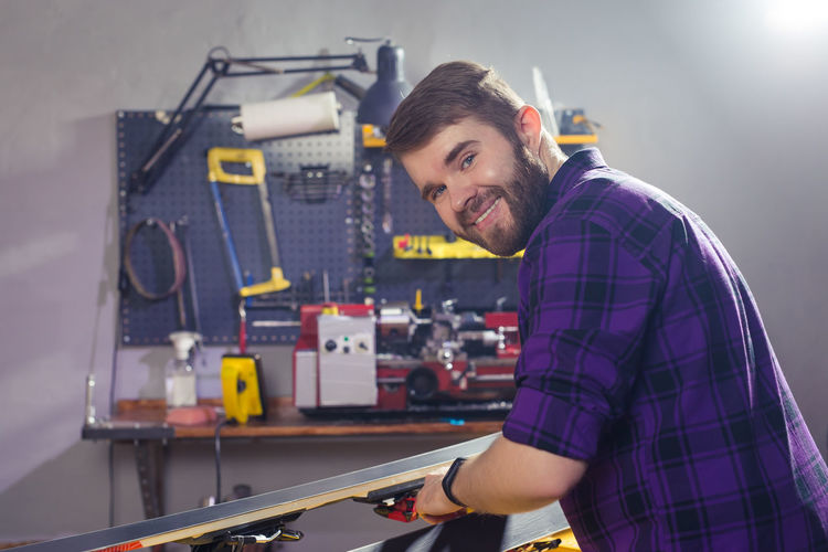 Portrait of smiling man working in workshop