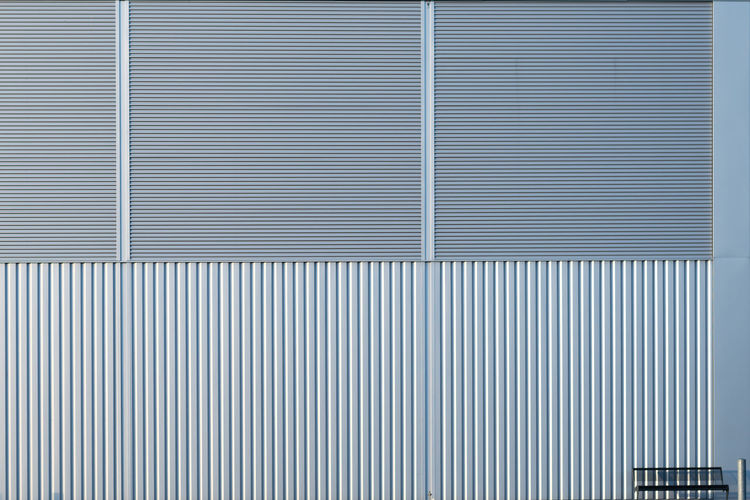 Metallic wall of building in city
