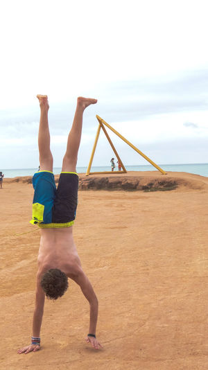 ezefer Athlete Balance Beach Day Exercising Full Length Healthy Lifestyle Human Body Part Lifestyles Motivation One Boy Only One Person Outdoors People PipaRN Real People Sea Self Improvement Sky Sport Sports Training Strength Upside Down