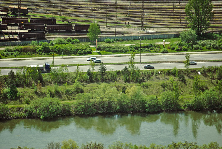 Cars Road Traveling Freight Transportation Green Color Landscape Landscape Layers Mode Of Transportation Motor Vehicle Nature Outdoors Patterns Railway Reflection River Transportation View From Above