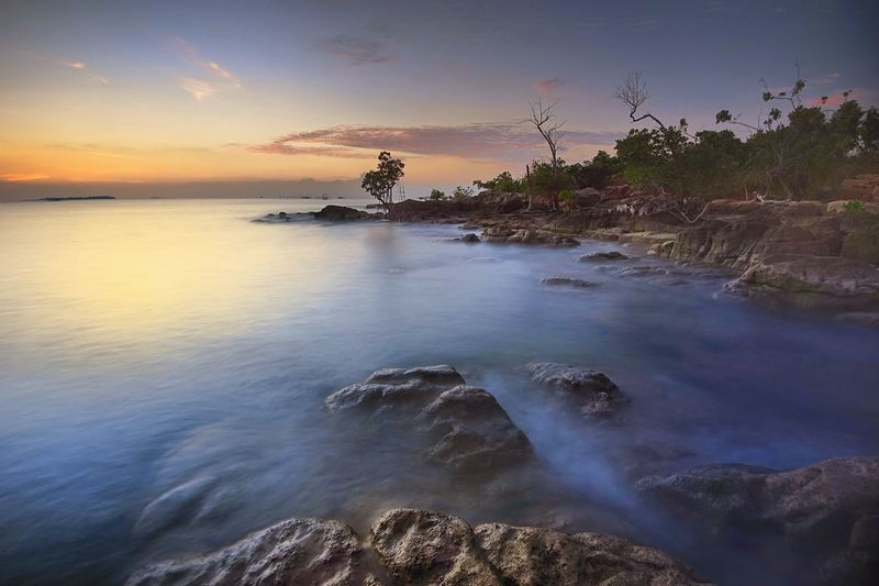sei nam aphace stoone,bintan island Bintanisland Alfatihgibranabbas Adventurephotography_kepri Adpgindonesia Kepri INDONESIA Landscape_photography Blue Sky Water Tree Sea Sunset Beach Blue Beauty Nautical Vessel Long Exposure Low Tide Rushing Romantic Sky Coastline Lagoon Tide Seascape Moody Sky Coastal Feature Rocky Coastline