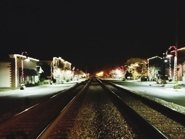 Christmas Track Lighting Night Illuminated The Way Forward Railroad Track Winter Transportation Cold Temperature Outdoors No People Sky