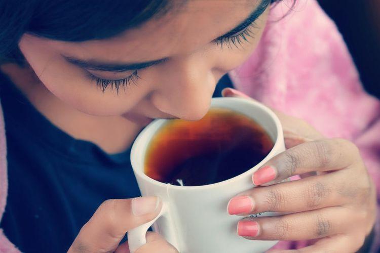 High angle view of woman drinking tea