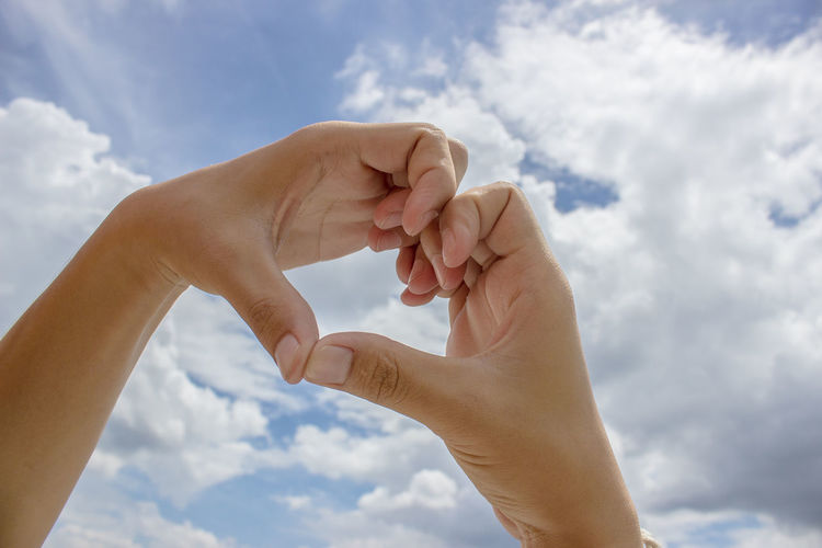 Human Hand Hand Human Body Part Cloud - Sky Sky Body Part Two People Real People Day Nature Adult Positive Emotion Lifestyles People Togetherness Personal Perspective Low Angle View Love Women Bonding Finger Human Limb Care