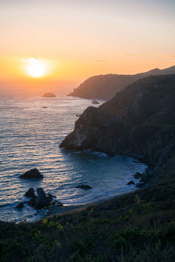 Beach Beauty In Nature Day Horizon Over Water Mountain Nature No People Outdoors Rock - Object Scenics Sea Sky Sun Sunlight Sunset Tranquil Scene Tranquility Water Wave