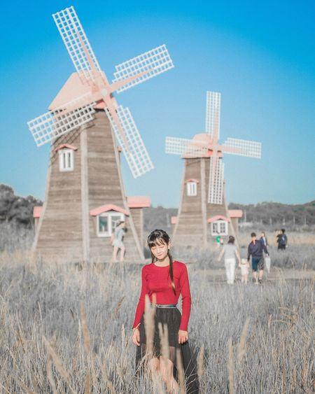 Rural Scene Wind Power Full Length Technology Environmental Conservation Blue Renewable Energy One Person Alternative Energy Wind Turbine Growth Outdoors Motion Childhood Nature Sky Day People Architecture
