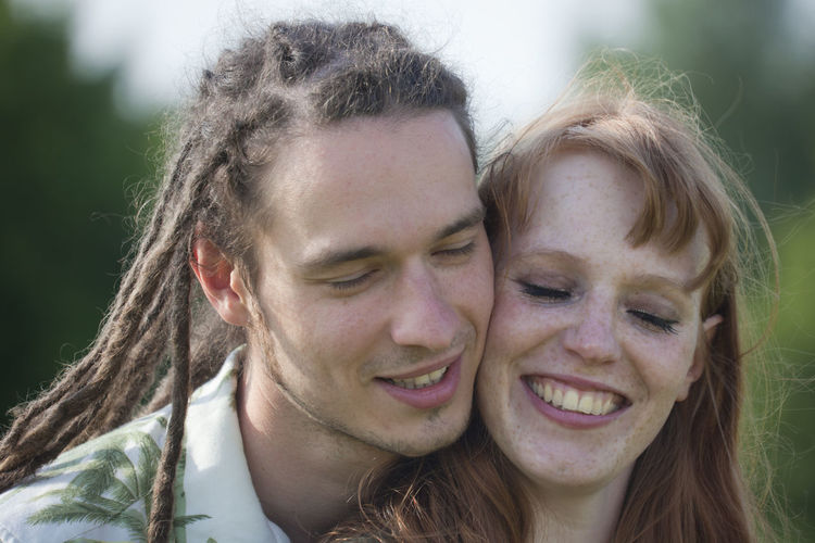 Close-up of happy couple with eyes closed