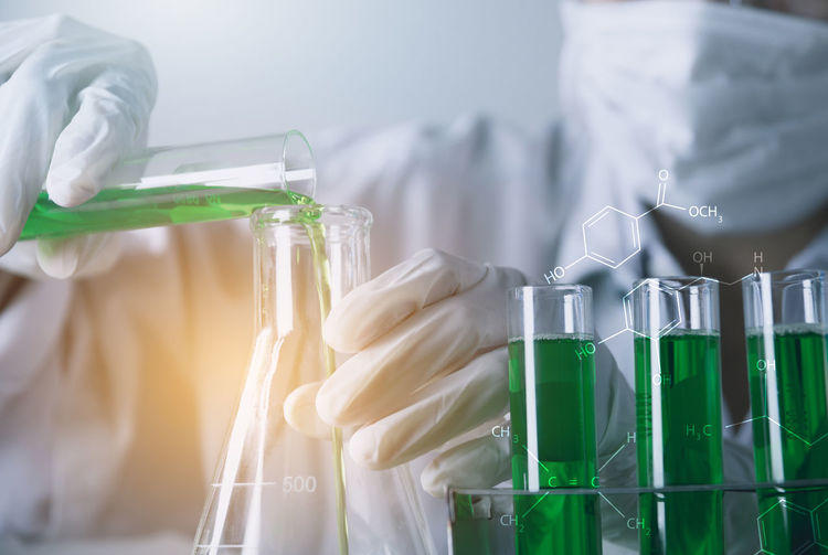 Analyzing Biochemistry Biology Biotechnology Chemical Chemistry Close-up Education Green Color Healthcare And Medicine Indoors  Laboratory Laboratory Glassware Occupation Protection Protective Workwear Research Safety Science Scientific Experiment Scientist Transparent