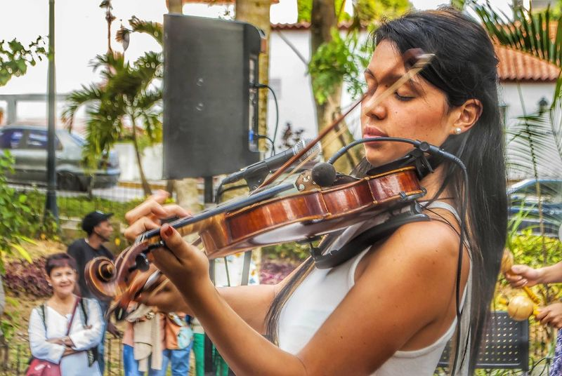EyeEm Selects Music Only Women Musician Young Adult Playing Adults Only Adult Arts Culture And Entertainment Young Women People One Woman Only Musical Instrument Performance Day Side View Outdoors Women One Person One Young Woman Only Plucking An Instrument