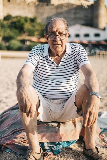 Full length portrait of senior man on sand