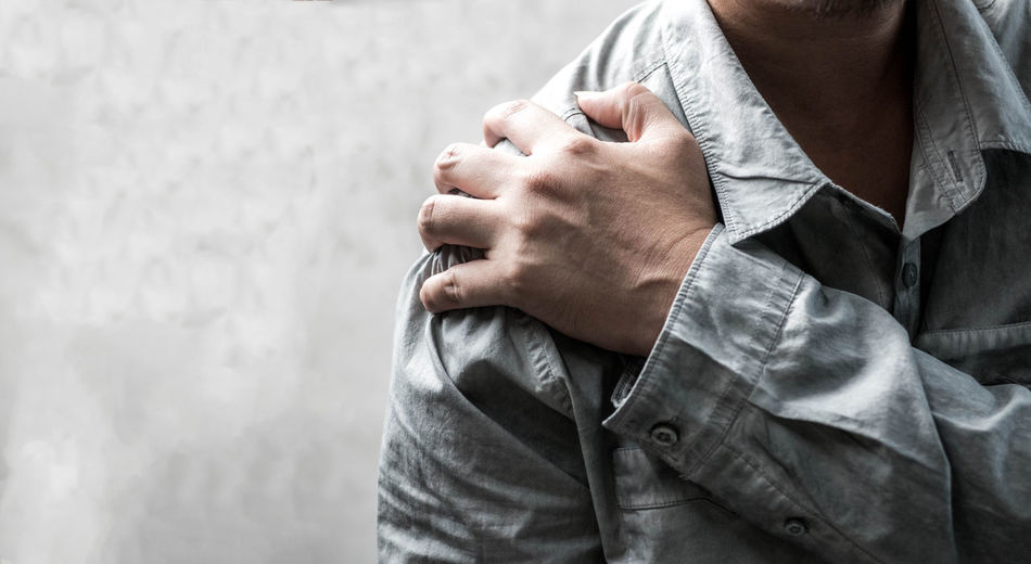 Pain Shoulder Pain Adult Arm Around Bonding Care Casual Clothing Couple - Relationship Day Emotion Focus On Foreground Human Hand Indoors  Lifestyles Love Men Midsection People Positive Emotion Real People Standing Togetherness Two People Women