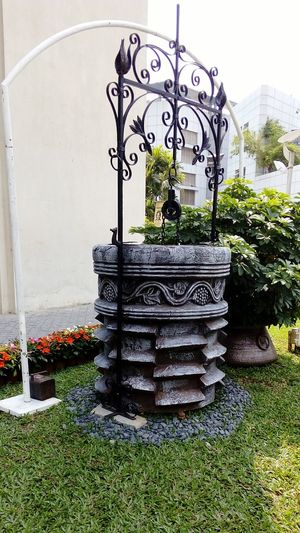 Wishing Well Decoration ArtWork Art And Craft Artworld Well  Chain Pulley Grassy Field Gardens Art And Nature Creativity