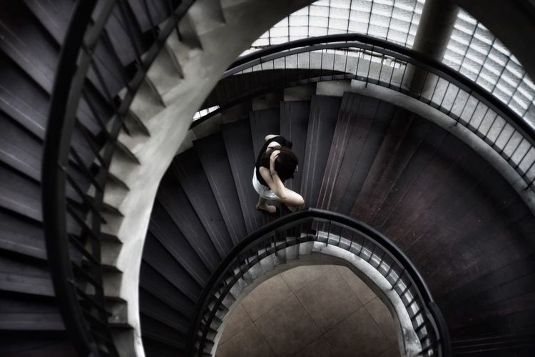 Never give up darkness and light Slow Life Walking Going Up Move On Architecture Staircase One Person Steps And Staircases Spiral