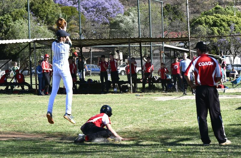 Full length of men playing on field