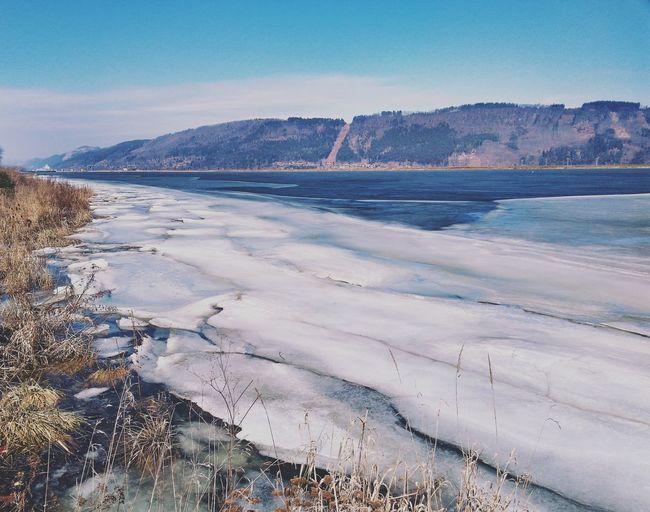 Frozen River Riverbank Mountains Blue Sky Landscape Winter Landscape Spring Has Arrived Snow Outdoors Sea Cold Temperature Landscape Beach Winter