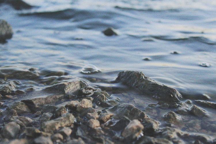 Close-Up Of Stones At Lakeshore