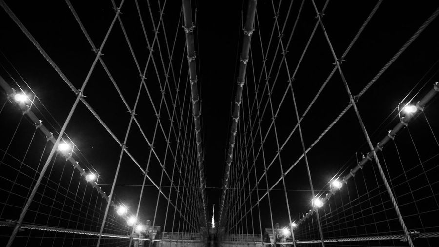 Low Angle View Of Brooklyn Bridge Against Sky At Night