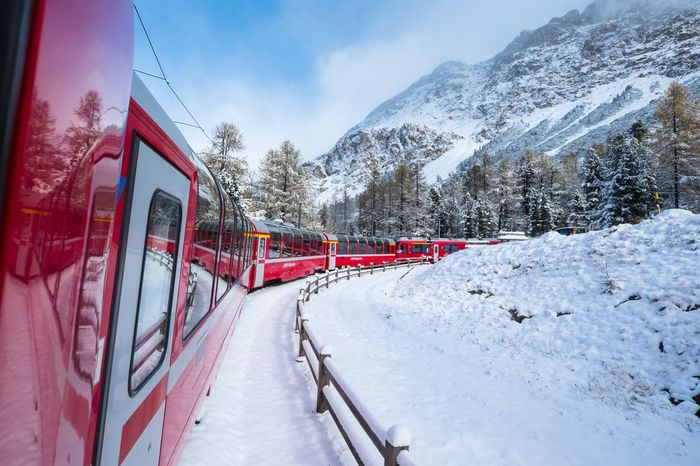 Sound Of Life the joy of travelling in a train lies in its rhythmic sound while it chugs away, more so when it's in such a scenic ride Train Vehicle Transport Snow Switzerland Europe Travel Holiday Edge Of The World