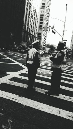 City City Life Street Photography City NYC Street Photography NYC Photography New York City Black And White Light And Shadow United States Manhattan Nypd Cop Serve And Protect Ny Streets