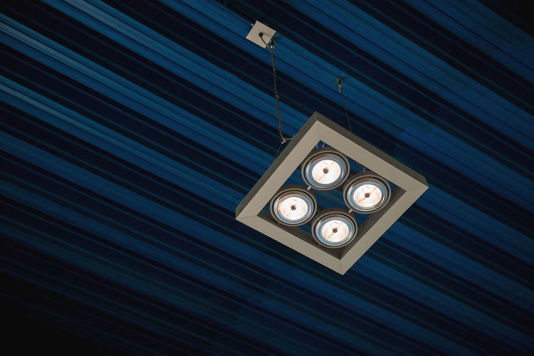 Low Angle View Of Illuminated Ceiling Lamp