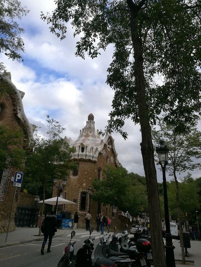 Park Guell Barcelona, Spain Gaudi Skate Photography: Same Tricks, New Perspectives Tree City Statue Sculpture Place Of Worship Sky Architecture Building Exterior Cloud - Sky Built Structure Historic History Historic Building The Past Archaeology Castle Fort Visiting