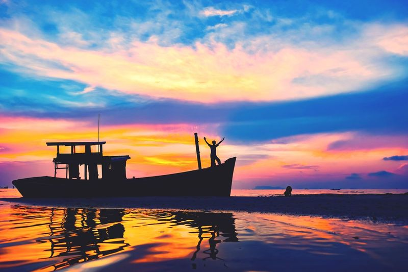 Sunset Water Sky Cloud - Sky Sea Nautical Vessel Orange Color Scenics - Nature Transportation Nature No People Beauty In Nature Tranquil Scene Mode Of Transportation Reflection Tranquility Outdoors Moored Silhouette Waterfront