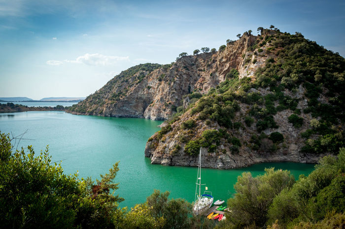 Landscape of the reservoir from Algar Sharp Day Environment Travel Destinations Majestic Green Color Blue Water Sky No People Outdoors Landscape Scenics - Nature Mountain Plant Beauty In Nature Tranquil Scene Tranquility Nautical Vessel Tree Sea Cloud - Sky Non-urban Scene Transportation Idyllic Mountain Range Turquoise Colored EyeEmNewHere Rock