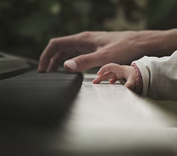 Father and baby playing the piano