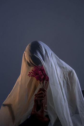 Mysterious man holding flower