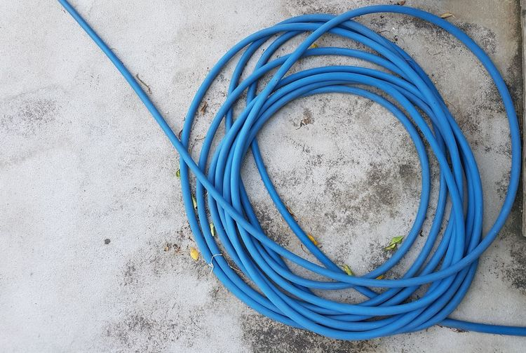 High angle view of blue pipe on floor