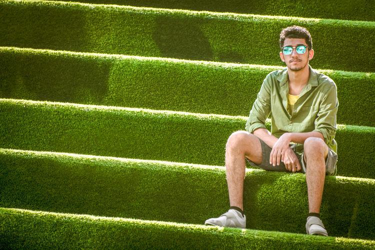 Portrait of man sitting on grass