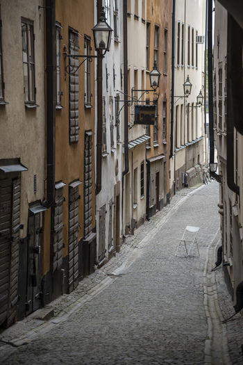 Alley amidst street in city