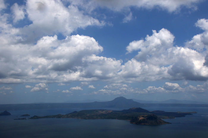 Taal Volcano is seen at Taal Lake, south of Manila, Philippines. Philippines Taal Lake Taal Volcano Tagaytay Beauty In Nature Cloud - Sky Cloud Formations Day Horizon Over Water Mountain Nature No People Outdoors Scenics Sea Sky Tranquil Scene Tranquility Volcano Water