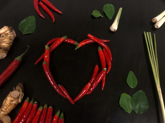 Lemon Leaves Lemon Grass Ingredients Chilli Heart Valentine's Day  Red Chillies Thai Spices Thai Still Life Ingredient Food High Angle View Food And Drink Heart Shape Indoors  Leaf No People Red Freshness