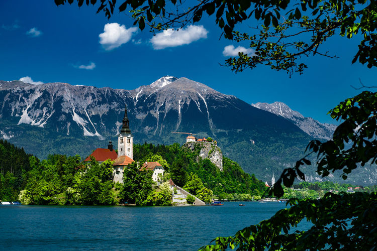 Lake Bled And Church Against Mountains