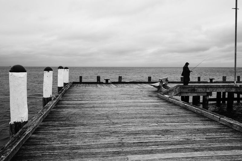 Athexphotographs Australia Blackandwhite Candid Decisive Moment Dramatic Fisherman Fishing Jetty Monochrome Pier Sea Streetphotography
