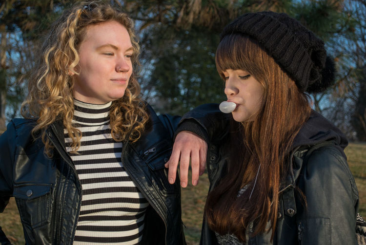 Two People Happiness Striped Outdoors Togetherness Day People Young Women Leisure Activity Only Women Bonding Young Adult Friendship Close-up Knit Hat Teenager Teenage Girls Syracuse Ny Cold Temperature Long Hair Bubblegum Blowing Bubbles Piercings