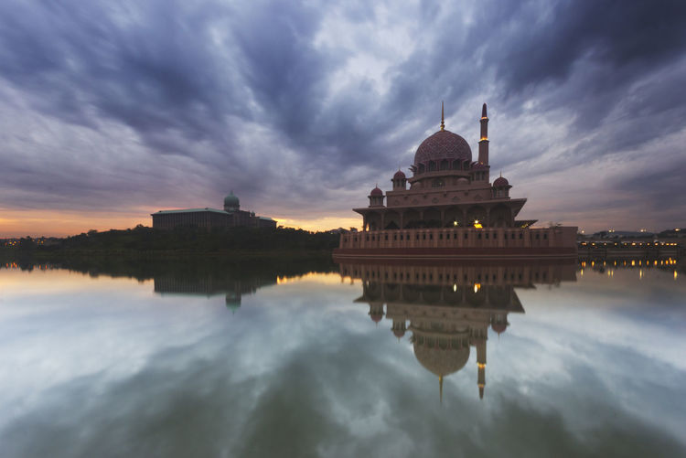 Reflection of dark clouds on calm lake. Architecture Architecture, Mosque, Religion, Islam, Asia, East, Famous, Minaret, Muslim, Dome, Landmark, Islamic, Sunset, Travel, Sky, Arabic, Religious, Dusk, Building, Evening, Ramadan, Marble, Culture, Grand, Reflection, Nature, Sunrise, Belief, Stone, Pillars, Pat Building Exterior Built Structure Cloud - Sky Day Dome History Nature No People Outdoors Place Of Worship Reflection Religion Sky Spirituality Sunset Travel Destinations Water Waterfront