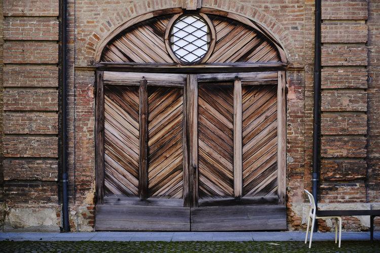 Closed wooden door of old building
