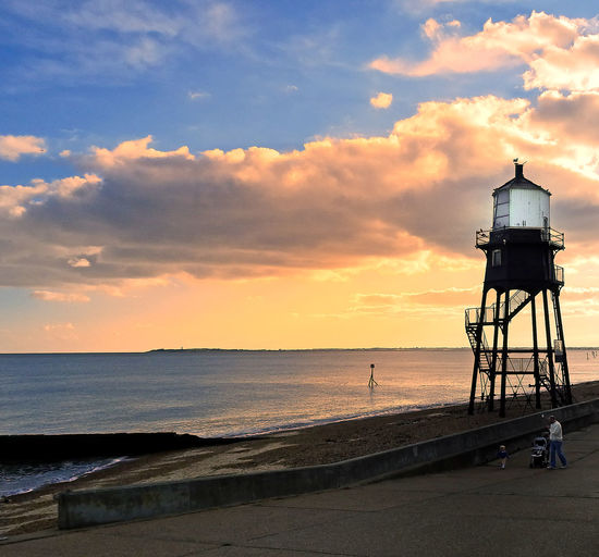 Architecture Sea Beach Water Sunset Nature Sky Silhouette Lighthouse Day Outdoors Tranquility Sand Scenics Beauty In Nature No People Harwich Orange Sunset Seaside Town Tranquil Scene Horizon Over Water Cloud - Sky Built Structure Victorian Lighthouse