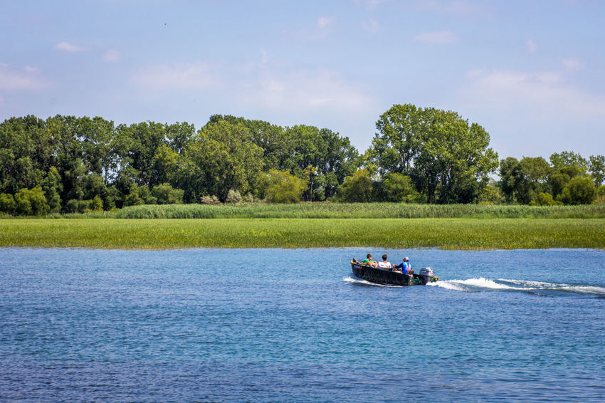 Boys outing Boating Detroit River Stoney Island Adventure Beauty In Nature Boys Fishing Boat Leisure Activity Michigan Outdoors Nature Nautical Vessel Outdoors Power Boat Real People River Togetherness Tree