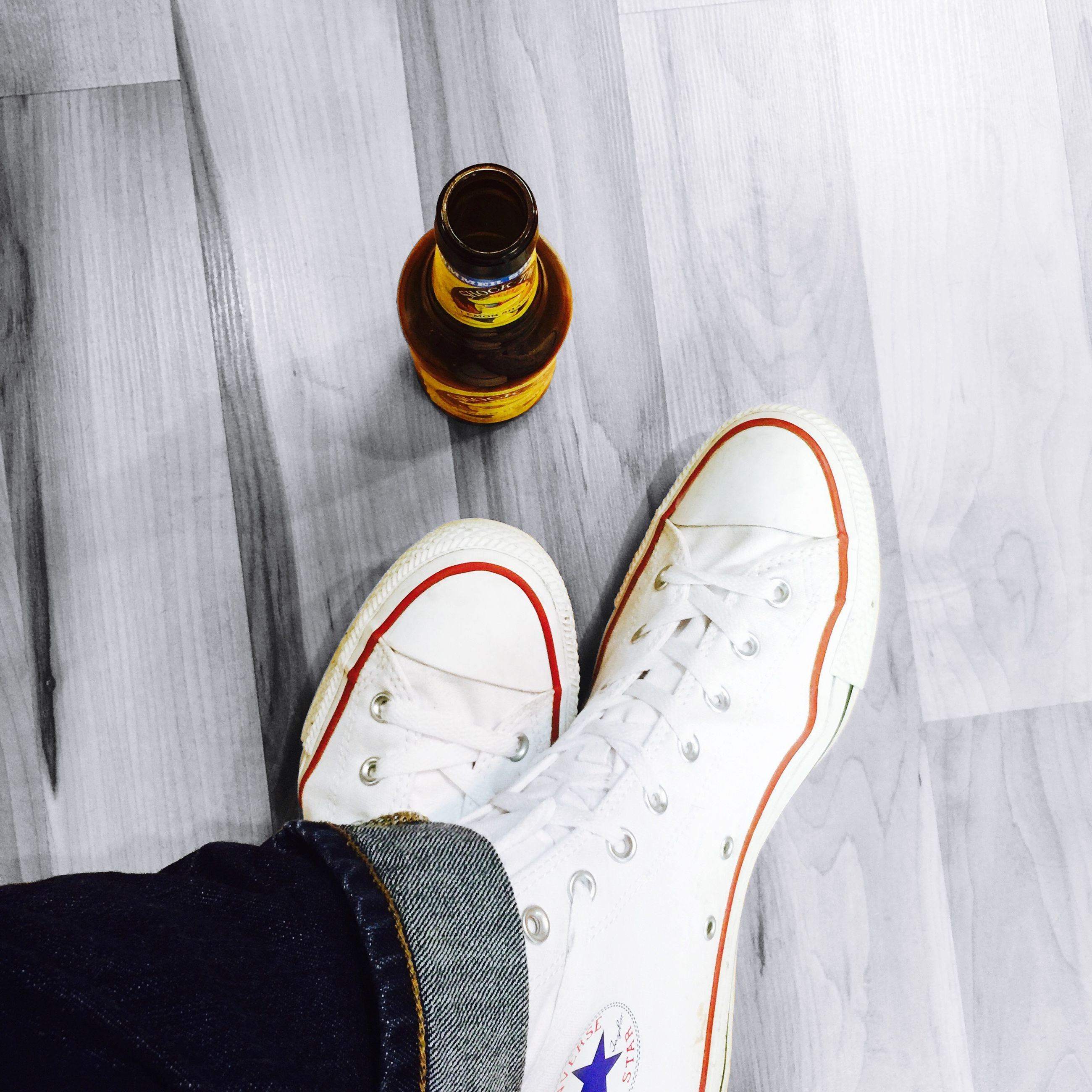shoe, indoors, high angle view, low section, footwear, still life, pair, person, close-up, personal perspective, directly above, fashion, table, bottle, flooring, floor, shadow, white color, personal accessory, human foot