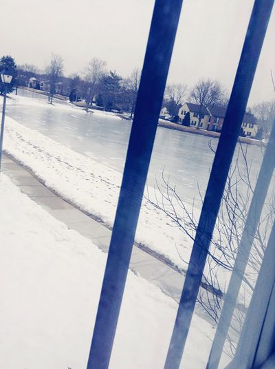 Right out side my house have a huge frozen pond, but the metal bars ruin the view . Taking Photos First Eyeem Photo