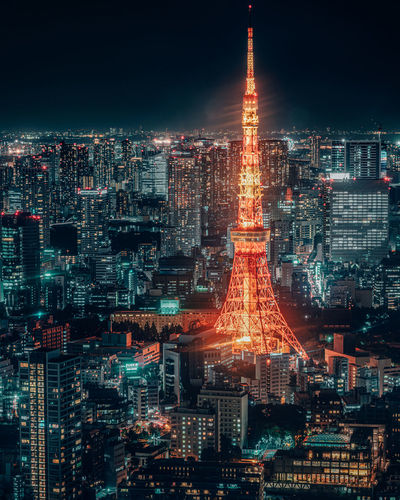 Aerial view of city lit up at night tokyo