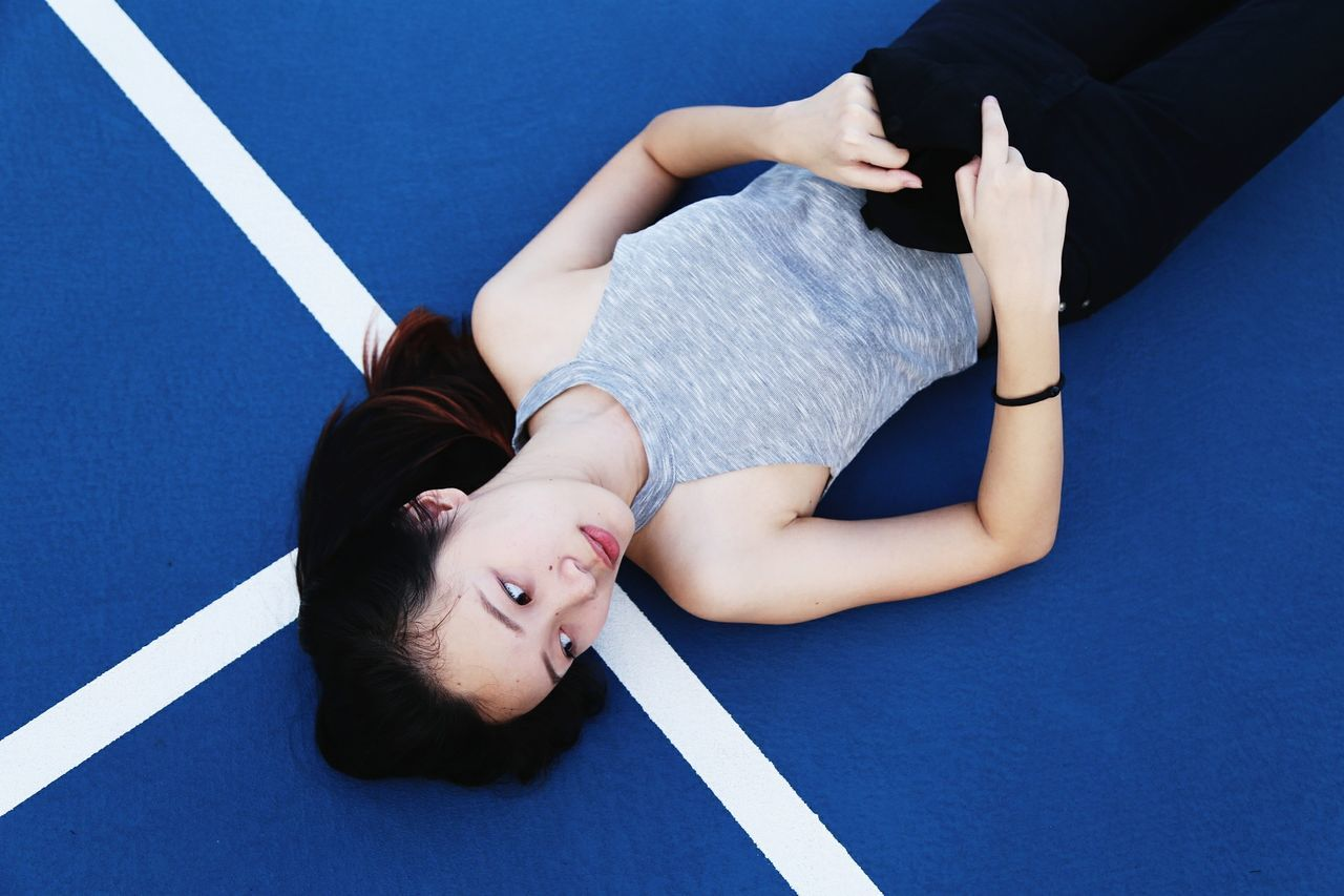 High Angle View Of Woman Lying On Court
