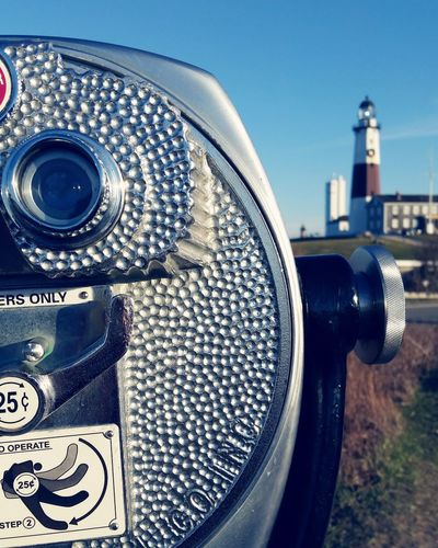 Close-up of coin-operated binoculars against montauk point